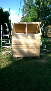 """Here you can see how """"siding"""" was fashioned out of pallet boards after taking several pallets apart."""