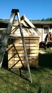 Here you can see how the pallets were put together in a box fashion and 2x4s were cut to create roof trusses.
