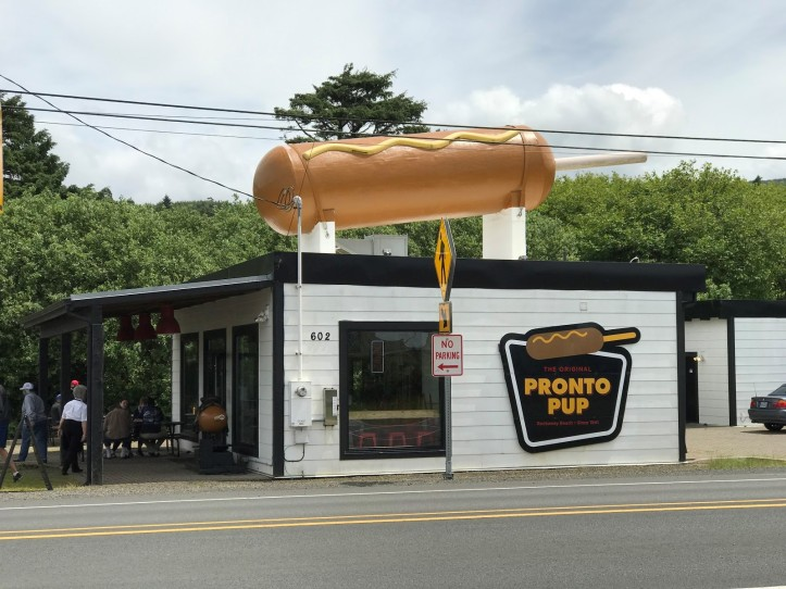 Visitors to Rockaway Beach can't miss the enormous corn dog on top of The Original Pronto Pup - Photo courtesy of Bella Culinary Adventures